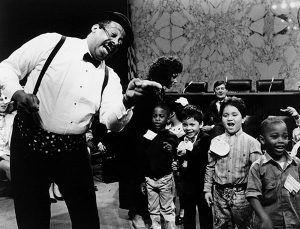 Black-and-white photo of Kinderman with children, ca. 1980s