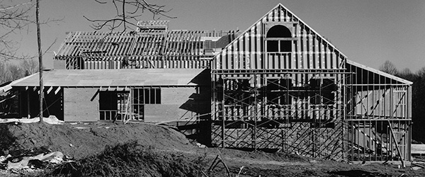 Using the traditional gin pole and pulley and block and tackle method, the German barn and Scottish barn were rebuilt on their present site in 1981 to create The Barns at Wolf Trap. Photo by Wolf Trap Foundation.